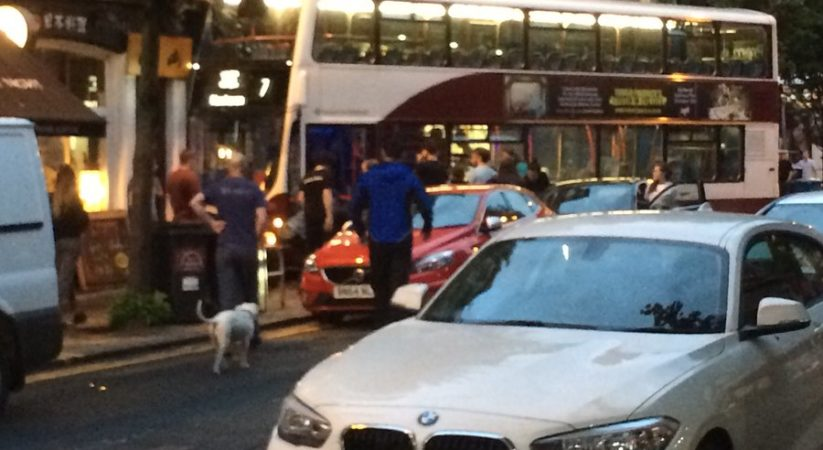 Forrest Road closed after bus mounts pavement and crashes into building