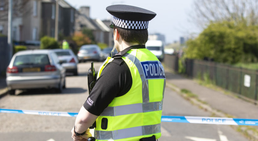Police seal off street and wooded area in Granton
