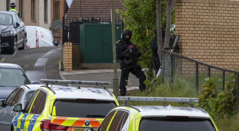 Armed police surround flats in Lochend