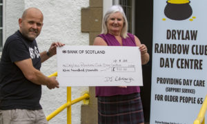 Edinburgh DJ hands over £900 donation to food bank